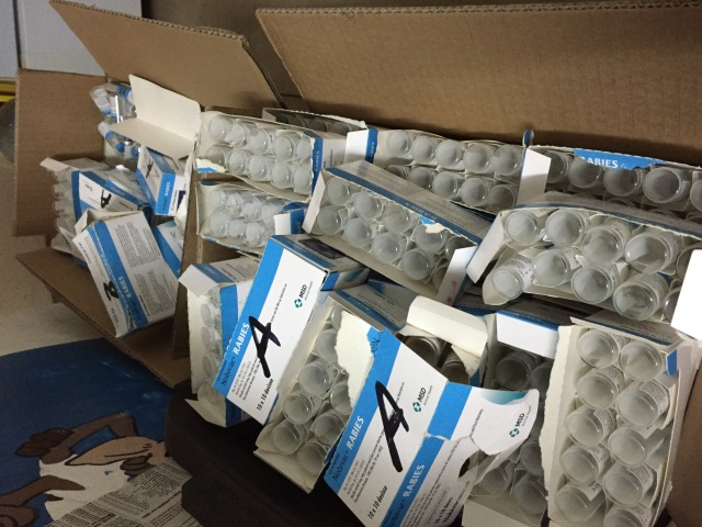 Boxes of empty vaccine bottles