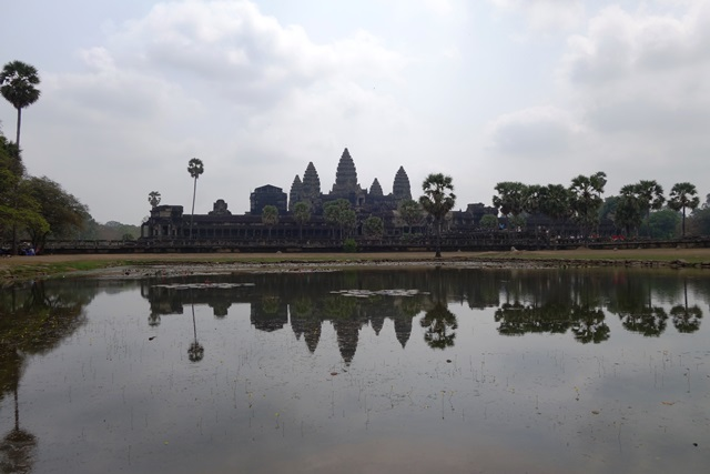 Siem Reap on the bank of a river, with the image reflected in the water