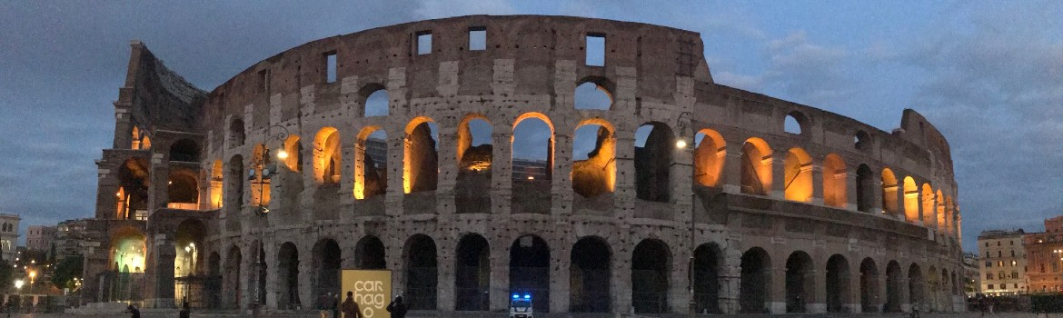 The Coliseum at night, lit up