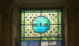 Banner image for OIE General Session -Stained glass window featuring the letters O, I, E and the silhouettes of animals
